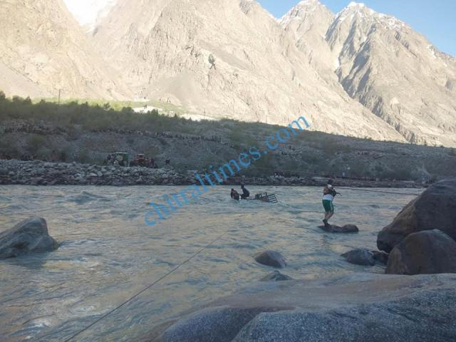 chitral a vehicle plunged into river in Yarkhoon valley while crossing Onawoch bridge resulting nine persons died including two women. pic by Saif ur Rehman Aziz 6