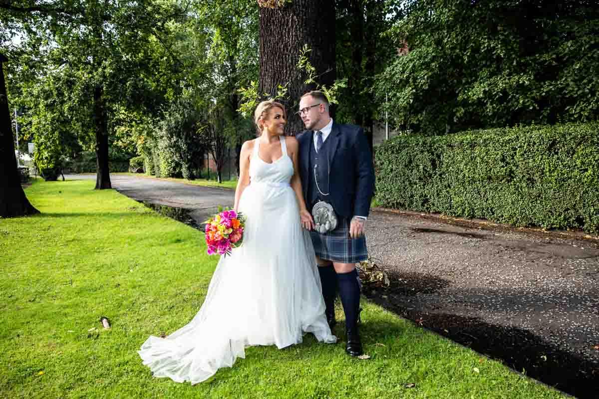 Best Glasgow wedding photographer, The Dumbuck Hotel wedding. Bride and groom on the grass