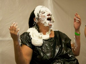 Mistress Messiér receives a pie in return at the Debauchery 2012 messyplay demo.