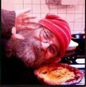 Santa's helper making pizza
