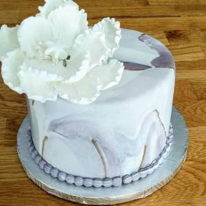 A simple yet elegant one tier cake marble effect withhellip