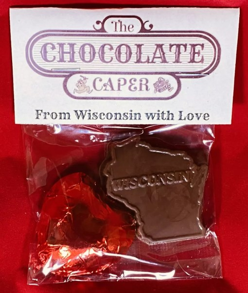 "A milk chocolate ""From Wisconsin with Love"" containing a dark chocolate heart wrapped in red foil and a solid dark chocolate shaped like the state of Wisconsin."