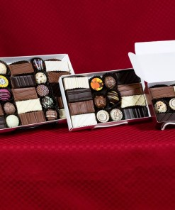 an assortment of heart caper praline truffle combinations in seven, fourteen and twenty-five-piece boxes