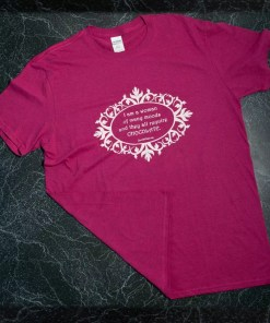 A heathered pink t-shirt with the words