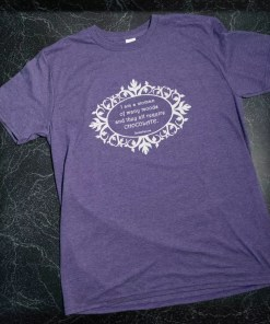 "A heathered purple t-shirt with the words ""I am a woman of many moods, and they all require chocolate"" in white on the front."