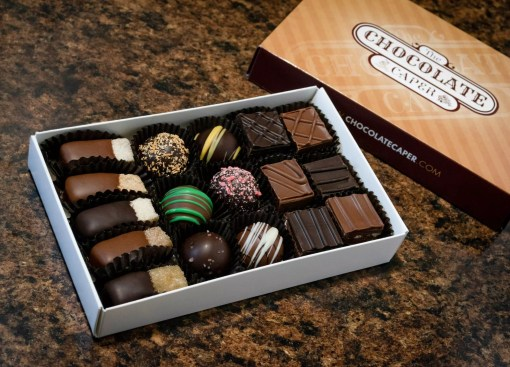 A small deluxe wine-lovers seasonal assortment containing 6 1/2 pieces of praline, 6 truffles and 5 wine gels