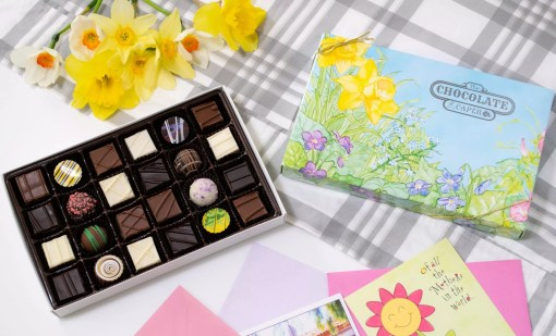 a large seasonal assortment with a spring box lid laid out with flowers around them