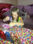 The birthday girl is engrossed in the activity