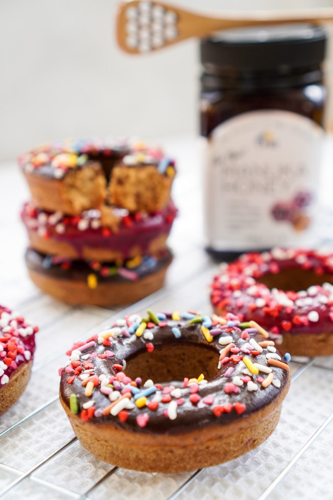 manuka honey donuts decorated in chocolate and sprinkles.