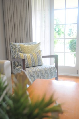 Custom upholstered chair with coordinating cushions
