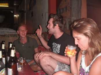 Playing drinking games at Central Backpackers in Vang Vieng, Laos.