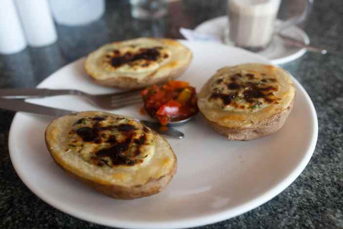 Cafe latte and coriander cheese potatoes in Kovalam, India.