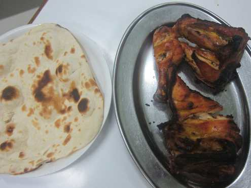 Tandoori chicken in Mumbai, India. (Though, I said not spicy and so he just brought me plain roasted chicken...)