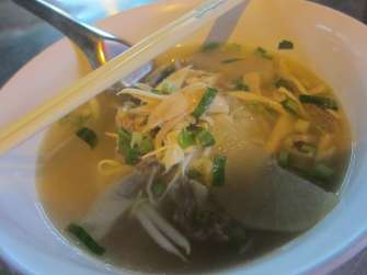 Street-side chicken soup in Bangkok, Thailand.
