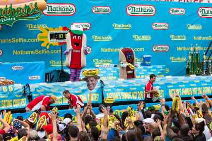 Hot dogs throw t-shirts to the crowd at the Nathan's Famous July 4 Hot Dog Eating Contest 2015.