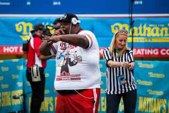 """Eric """"Badlands: Booker performs an eating contest rap at the Nathan's Famous July 4 Hot Dog Eating Contest 2015"""