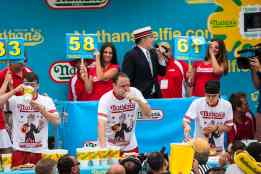 Joey Chestnut Eats at the Men's Contest at the 2015 Nathan's Famous July 4 Hot Dog Eating Contest