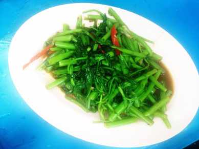 Pad Pak Boong Fai Daeng. Fried Morning Glory . Oh how I miss thee. Fried morning glory is just one of those dishes you can't get in the US. The crisp greens in a spicy chili and garlic sauce is both healthy and satisfying and so tasty.