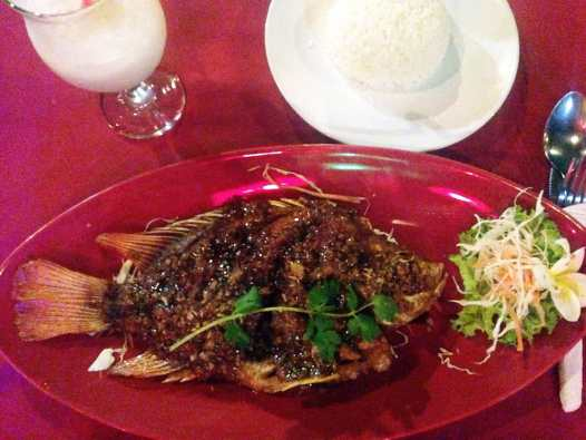 A giant whole fish - this one cooked with pepper and garlic - is a must have dinner if you're on the beach.