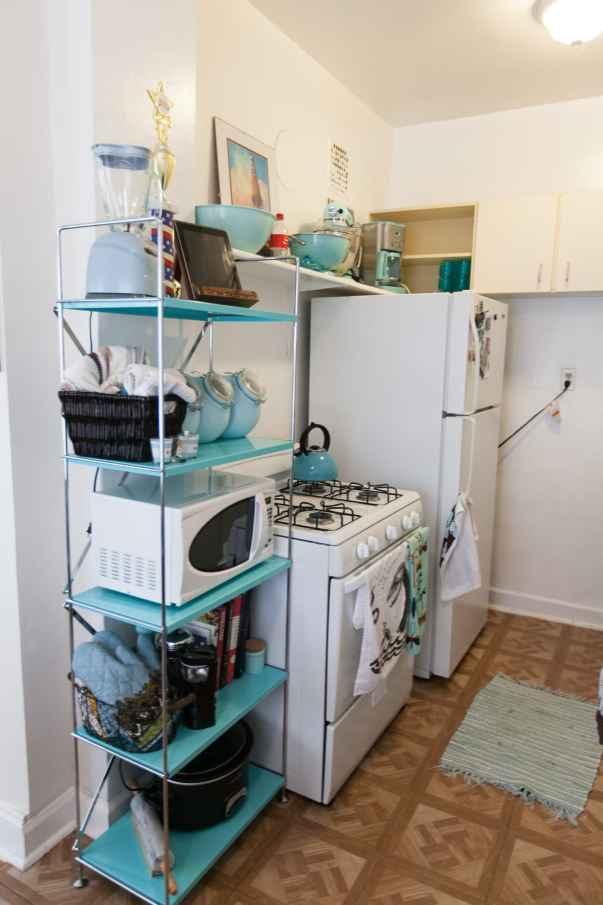 Teal kitchen shelving.