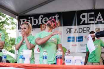 Competitive eaters await the results of Ribmania Ribs Eating Contest at Ribfest Chicago