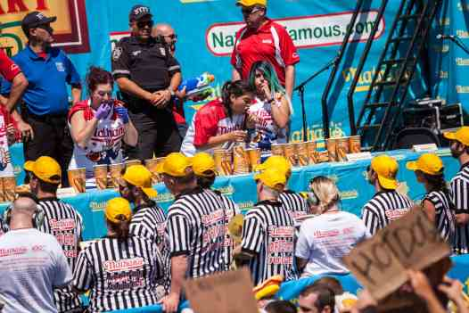 Kassie Zapata eats at the 2016 Nathan's Famous hot dog eating contest at Coney Island.