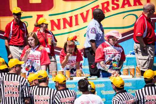 Mary Bowers eats at the 2016 Nathan's Famous hot dog eating contest at Coney Island.