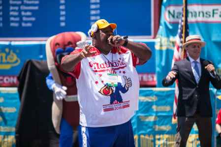 Eric 'Badlands' Booker performs at the 2016 Nathan's Famous hot dog eating contest at Coney Island.