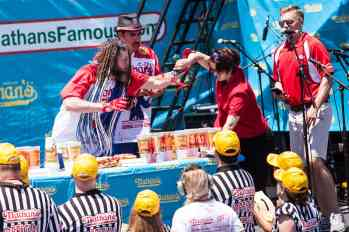 Vegan protestor splashes fake blood at the 2016 Nathan's Famous hot dog eating contest at Coney Island.