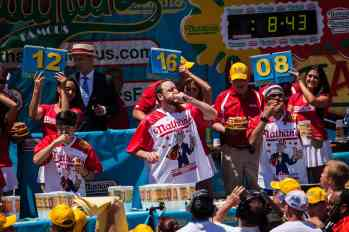 Joey Chestnut eats at the 2016 Nathan's Famous hot dog eating contest at Coney Island.