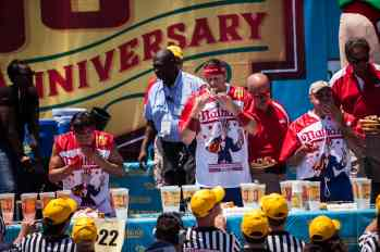 Erik Denmark eats at the 2016 Nathan's Famous hot dog eating contest at Coney Island.