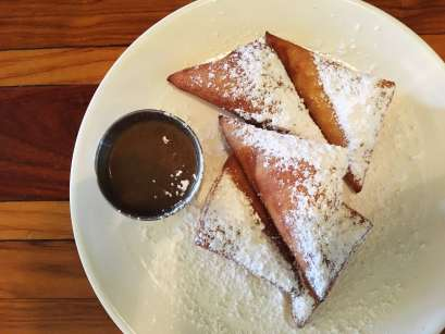 Beignets at Toulouse Petit in Seattle, Washington.