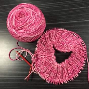 Making progress on knitting a hat.