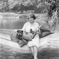 1925Actress/Singer  Madge Saunders with her chow puppy