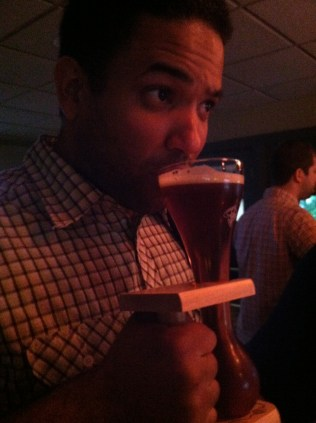 Chris drinks a Kwak