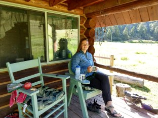 Sipping tea & coffee on the front porch of our cabin