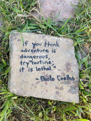 Llama lodge quote on stone
