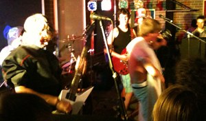 Alex on lead guitar (on left) in the semi-finals