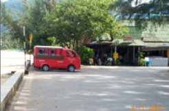 This is a taxi rank at Kamala Bay in front of a restaraunt. Note the blue hi-rise in the background - you can just see it through the trees.