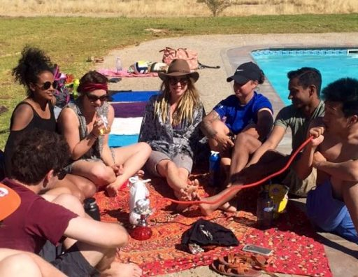 PC Trainees relax around one of the pools at Gross Barmen, sharing a hookah.