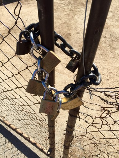 ... beyond the gate secured by this padlock-chain...