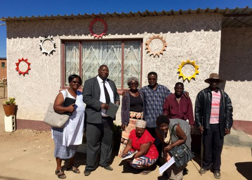 The Kalkfeld Shackdwellers and Arandis officials and residents photo stop in front of another new home.
