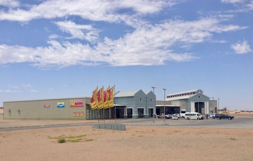 """One change that you can see in the aerial photos is our """"new"""" shopping center, housing the town's second market, a bank, a couple of clothing stores and other assorted shops. I'm working this week on certifying a new meat and biltong market as we continue to fill it out with tenants."""