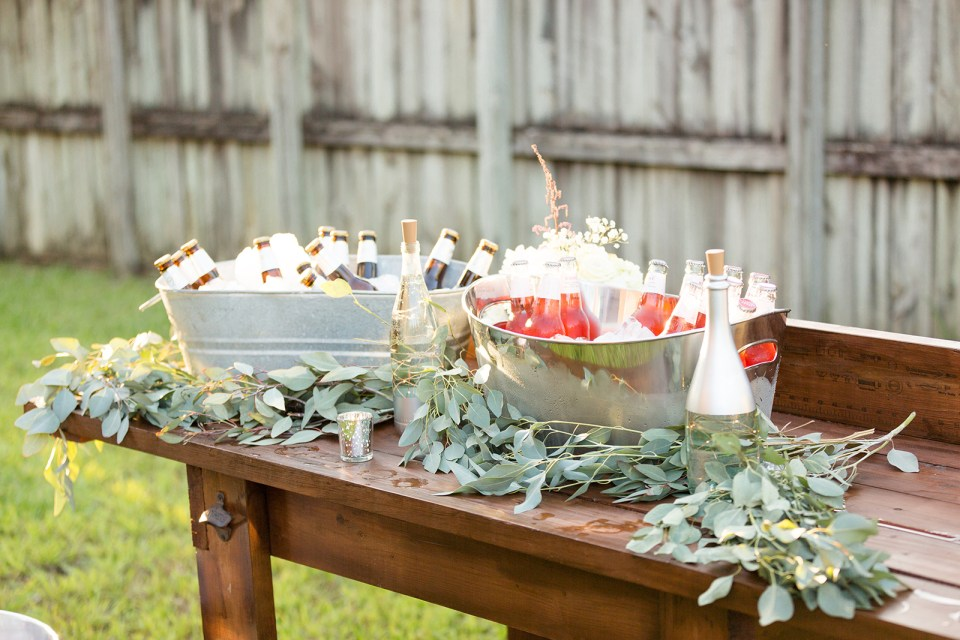 wooden table with greenery and drinks
