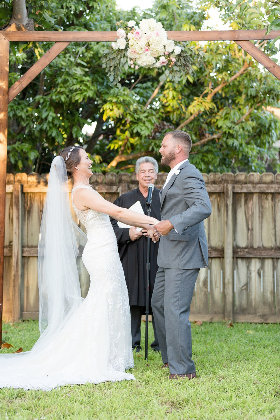 bride and groom excited about first kiss