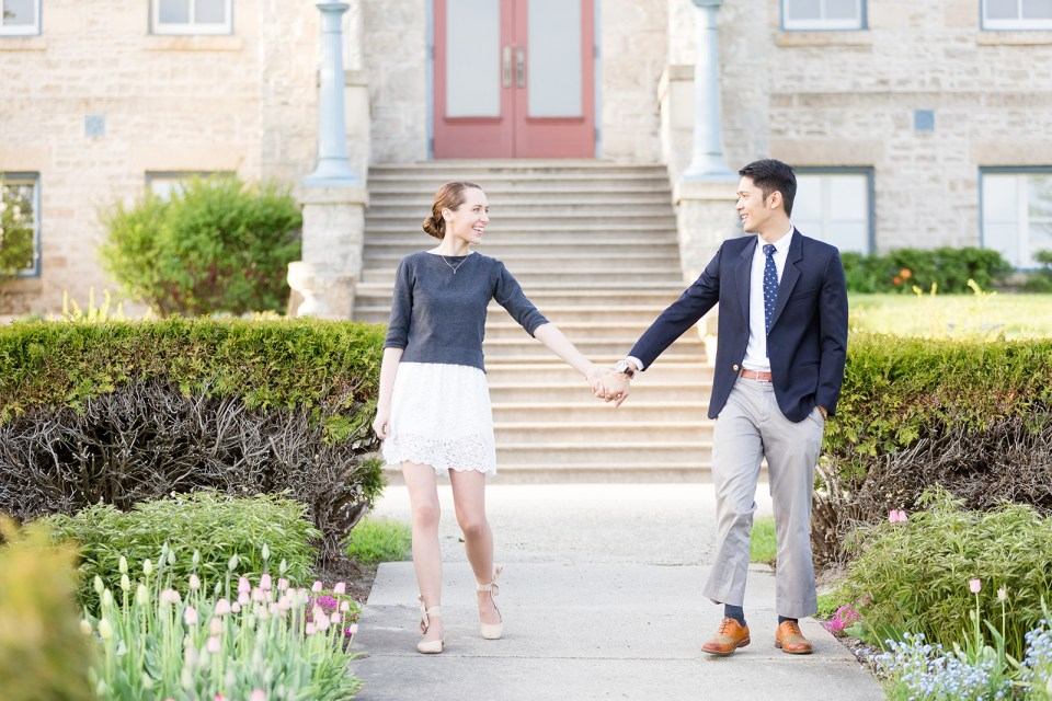 couple walking hand in hand while taking their Fergus Ontario engagement photos at the Wellington County Museum