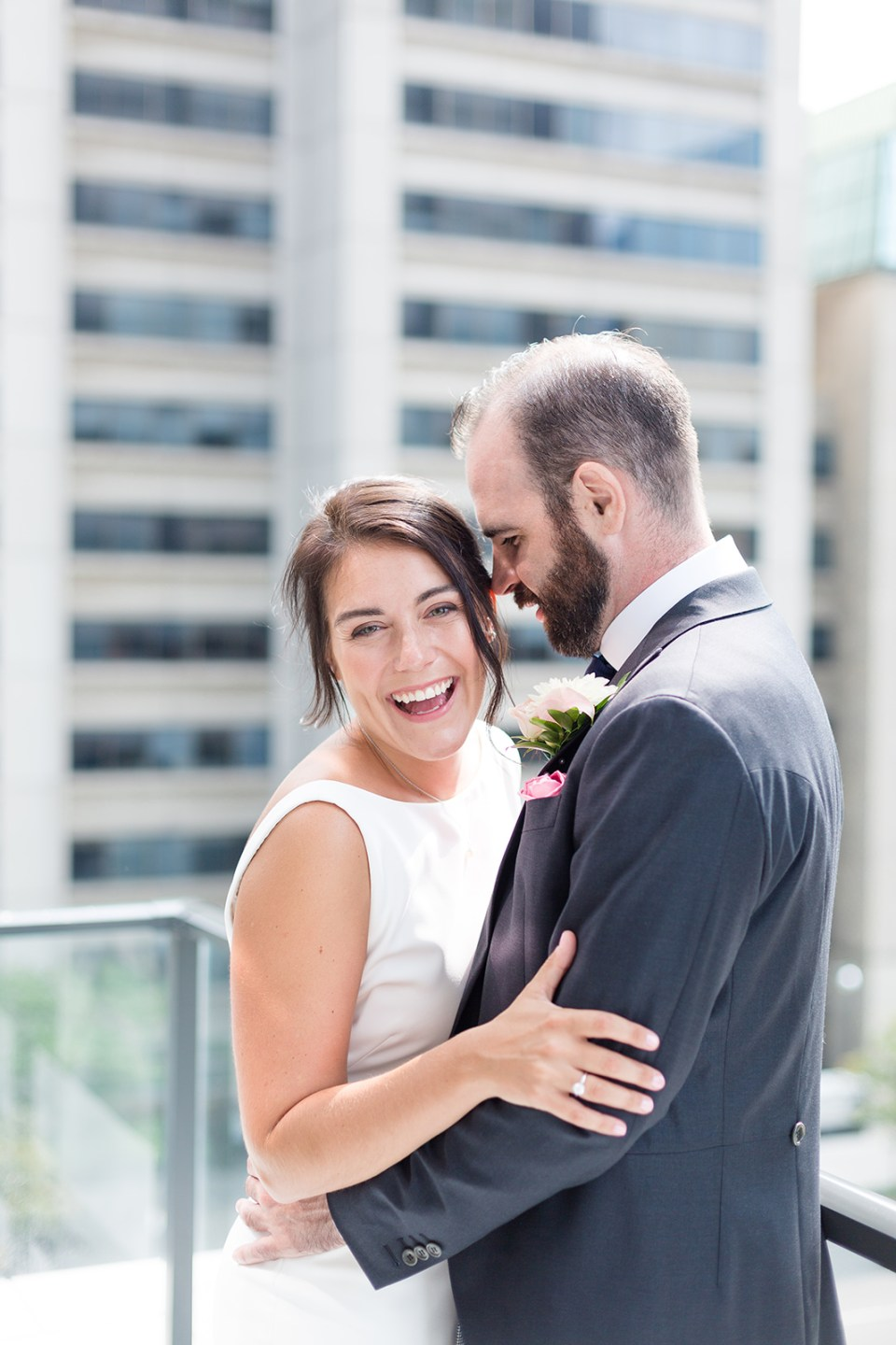 groom holding a bride while she is laughing