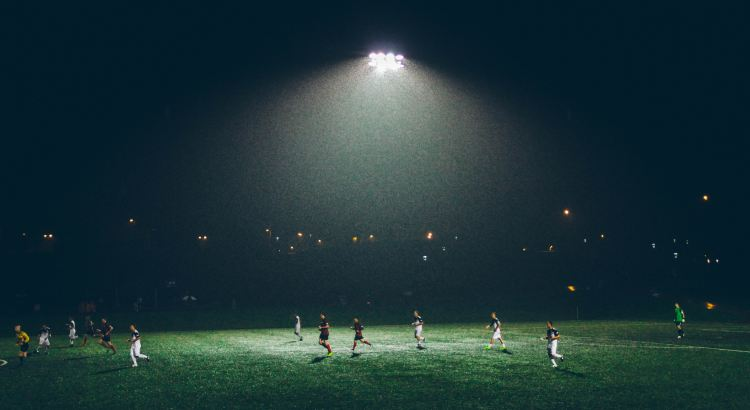 Picture of footballers playing at night