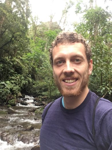 Picture of the author wading through a river on the Quetzal Trail