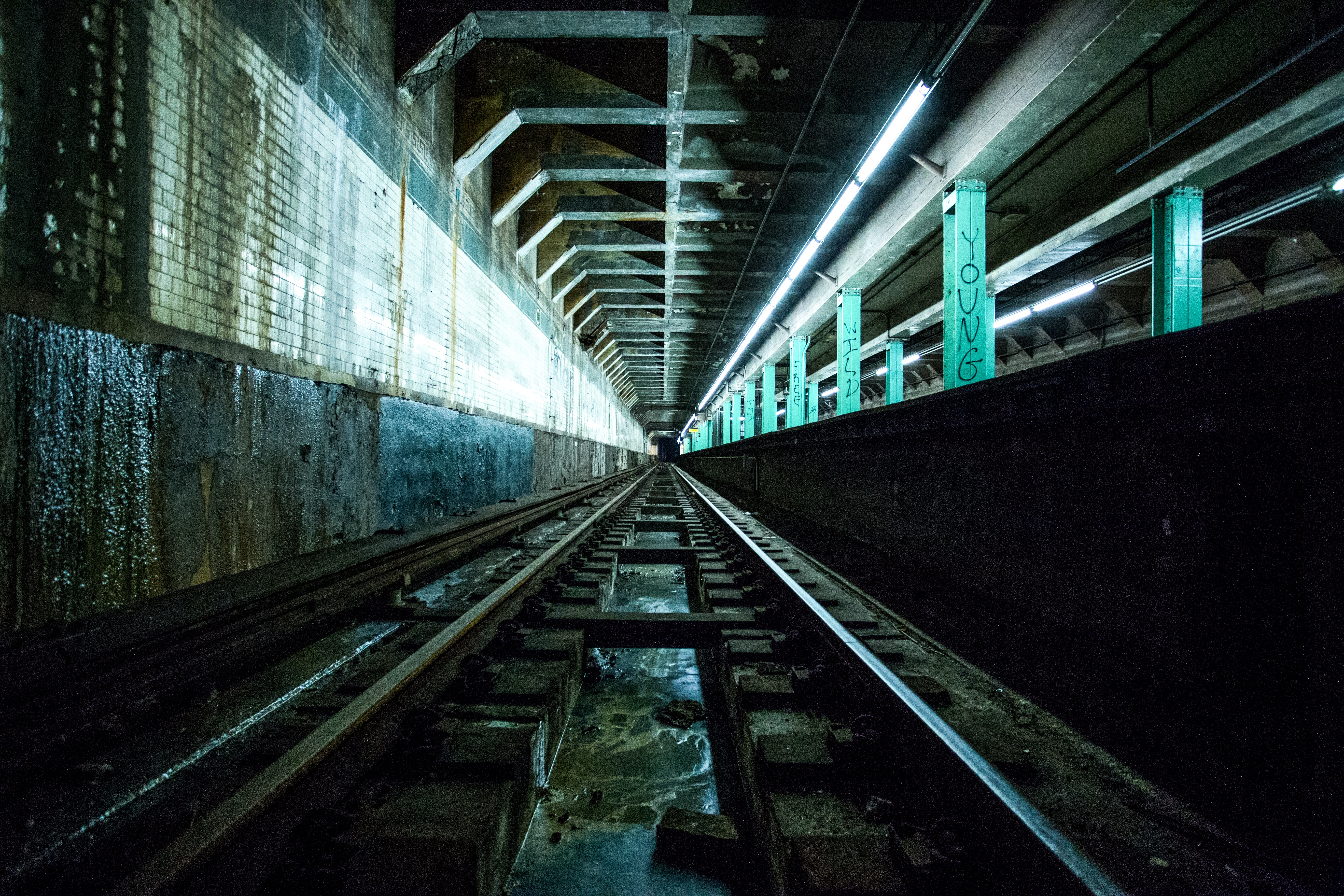 Closeup of subway tracks, entering a station, The Initiation